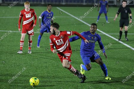 Ben Hunter of Sudbury and Mekhi Leacock-McLeod of Romford during Romford vs AFC Sudbury, BetVictor League North Division Football at Parkside on 4th March 2020