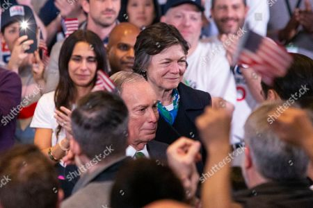 Former Democratic presidential candidate Michael Bloomberg (C) greets supporters at the end of his announcement of his campaign suspension and his endorsement of Vice President Joe Biden in Manhattan, in New York