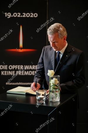 Former German president Christian Wulff, signs a condolence register during a memorial cermenony for the victims of the Hanau terror attack shootings, in Hanau, Germany, 04 March 2020. An offiical commemoration ceremony for the victims of the Hanau terror attack is broadcasted on screens at two public spaces in Hanau. Nine people were killed on 19 February 2020 in two shootings at shisha bars in Hanau. The perpetrator, a suspected far-right extremist, was found dead later at his home along with the body of his mother.