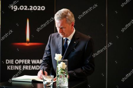 Stock Picture of Former German president Christian Wulff, signs a condolence register during a memorial cermenony for the victims of the Hanau terror attack shootings, in Hanau, Germany, 04 March 2020. An offiical commemoration ceremony for the victims of the Hanau terror attack is broadcasted on screens at two public spaces in Hanau. Nine people were killed on 19 February 2020 in two shootings at shisha bars in Hanau. The perpetrator, a suspected far-right extremist, was found dead later at his home along with the body of his mother.