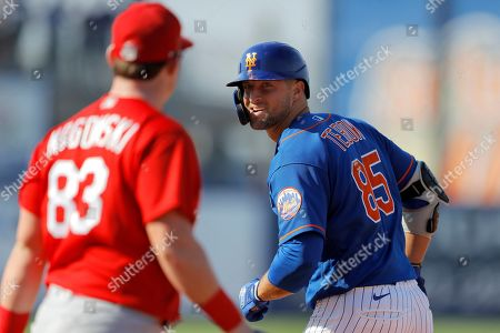 Stock Photo of New York Mets' Tim Tebow, right, looks at St. Louis Cardinals John Nogowski after Tebow ground out during the eighth inning of a spring training baseball game, in Port St. Lucie, Fla