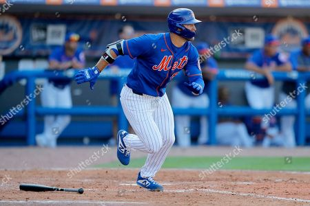 New York Mets' Tim Tebow runs out a ground out against the St. Louis Cardinals during the eighth inning of a spring training baseball game, in Port St. Lucie, Fla