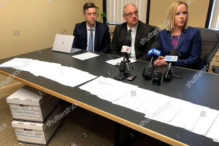 Stock Picture of Tim O'Keeffe, Michael Bryant, Tatum O'Brien. Attorneys, from left, Tim O'Keeffe, Michael Bryant and Tatum O'Brien talk about clergy sex abuse in North Dakota at a press conference in Fargo, N.D., . The boxes of documents at left include assignment histories of 53 clergy members with substantiated allegations of sexual abuse of a minor