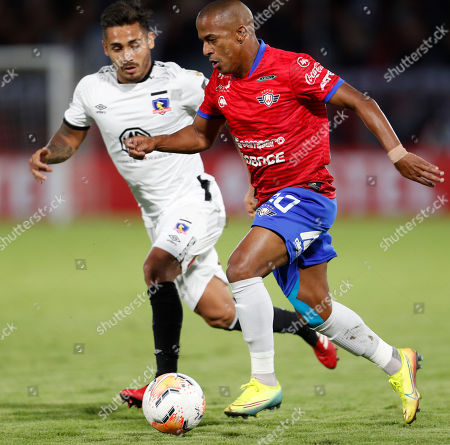 Stock Photo of Sergio Henrique Francisco, Marcos Bolados. Sergio Henrique Francisco of Bolivia's Jorge Wilstermann, rigth, fights for the ball with Marcos Bolados of Chile's Colo Colo during a Copa Libertadores soccer match at the Felix Capriles stadium in Cochabamba, Bolivia