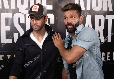 Enrique Iglesias, Ricky Martin. Enrique Iglesias, left, and Ricky Martin arrive at the Enrique Iglesias and Ricky Martin Press Conference at The London West Hollywood Hotel, in West Hollywood, Calif