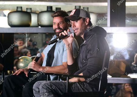 Enrique Iglesias, Ricky Martin. Ricky Martin, left, and Enrique Iglesias speak at the Enrique Iglesias and Ricky Martin Press Conference at The London West Hollywood Hotel, in West Hollywood, Calif