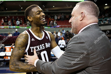 Stock Picture of Texas A&M guard Jay Jay Chandler (0) celebrates the win over Auburn with Texas A&M head coach Buzz Williams after an NCAA college basketball game, in Auburn, Ala