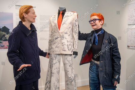 Sandy Powell and Tilda Swinton with the autographed outfit which is to be auctioned