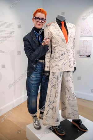 Sandy Powell with the autographed outfit which is to be auctioned