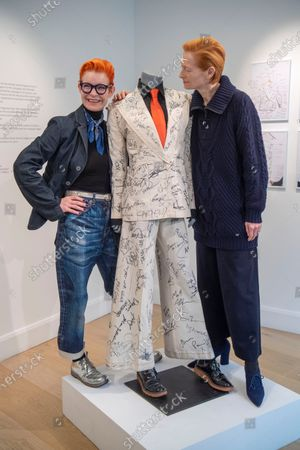 Stock Photo of Sandy Powell and Tilda Swinton with the autographed outfit which is to be auctioned