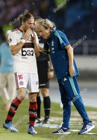 Jorge Jesus, Filipe Luis. Filipe Luis of Brazil's Flamengo talks to coach Jorge Jesus during a Copa Libertadores soccer match against Colombia's Junior at the Metropolitano Roberto Meléndez stadium in Barranquilla, Colombia