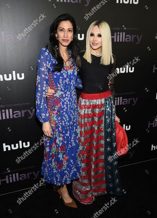"""Huma Abedin, Stacey Bendet. Political advisor Huma Abedin, left, and fashion creative director Stacey Bendet attend the premiere of the Hulu documentary """"Hillary"""" at the DGA New York Theater, in New York"""