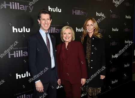 "Craig Erwich, Hillary Clinton, Dana Waldman. Former secretary of state Hillary Clinton, center, poses with Hulu's Craig Erwich, left, and Disney Television Studios and ABC Entertainment chairwoman Dana Walden at the premiere of the Hulu documentary ""Hillary"" at the DGA New York Theater, in New York"