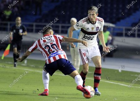 Marlon Piedrahíta (L) of Junior in action against Filipe Luis of Flamengo during a Copa Libertadores group A soccer match between Junior FC and Flamengo, at Metropolitano stadium in Barranquilla, Colombia, 04 March 2020.