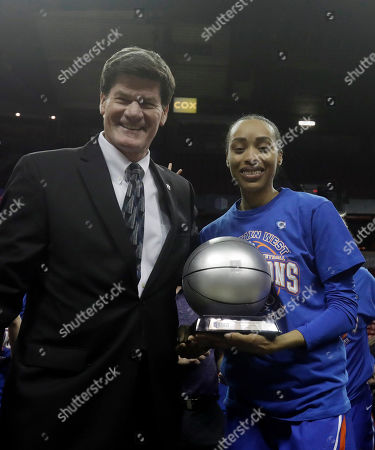 Boise State's A'Shanti Coleman is awarded the MVP trophy by Mountain West Conference commissioner Craig Thompson following a Mountain West Conference tournament championship NCAA women's college basketball game, in Las Vegas
