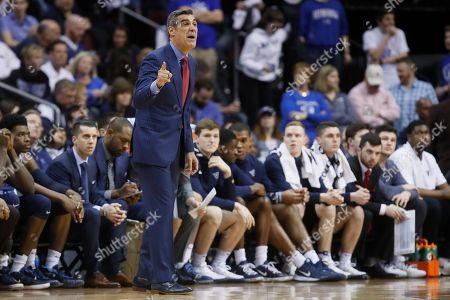 Villanova head coach Jay Wright directs his players from the bench during the second half of an NCAA college basketball game against Seton Hall, in Newark, N.J