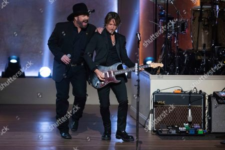 Garth Brooks, Keith Urban. Honoree Garth Brooks, left, and Keith Urban perform on stage during the 2020 Gershwin Prize Honoree's Tribute Concert at the DAR Constitution Hall, in Washington