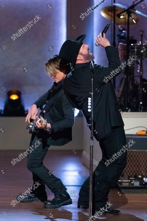 Garth Brooks, Keith Urban. Honoree Garth Brooks, right, and Keith Urban perform on stage during the 2020 Gershwin Prize Honoree's Tribute Concert at the DAR Constitution Hall, in Washington