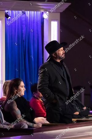 Stock Image of Garth Brooks listens as wife Trisha Yearwood performs on stage during the 2020 Gershwin Prize Honoree's Tribute Concert at the DAR Constitution Hall, in Washington