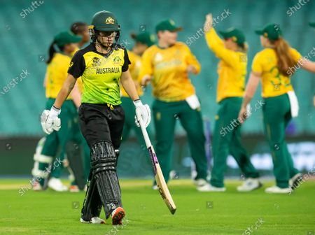 Alyssa Healy of Australia leave the field after being caught by Dane Van Niekerk of South Africa off the bowling of Ayabonga Khaka during the Women's T20 World Cup semi-final match between Australia and South Africa at the Sydney Cricket Ground (SCG) in Sydney, Australia, 05 March 2020.
