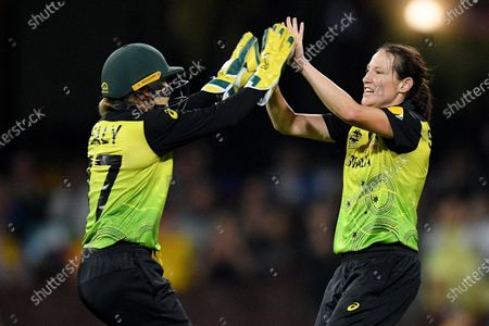 Megan Schutt of Australia (R) celebrates with Alyssa Healy (L) after taking the wicket of Dane Van Niekerk of South Africa during the Women's T20 World Cup semi-final match between Australia and South Africa at the Sydney Cricket Ground (SCG) in Sydney, Australia, 05 March 2020.