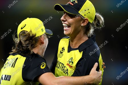 Ashleigh Gardner of Australia (R) celebrates with Georgia Wareham (L) after taking a catch to dismiss Lizelle Lee of South Africa during the Women's T20 World Cup semi-final match between Australia and South Africa at the Sydney Cricket Ground (SCG) in Sydney, Australia, 05 March 2020.