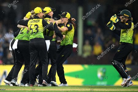 Alyssa Healy (R) and Megan Schutt (2-R) of Australia celebrate with teammates following their win over South Africa during the Women's T20 World Cup semi-final match between Australia and South Africa at the Sydney Cricket Ground (SCG) in Sydney, Australia, 05 March 2020.