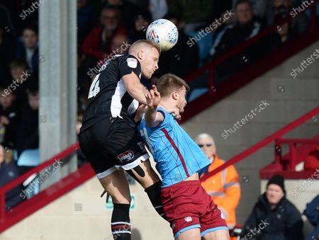Stock Image of Harry Davis of Grimsby Town go up for the aerial ball against George Miller of Scunthorpe United