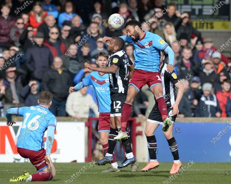 James Perch of Scunthorpe United gets to the ball ahead of Elliot Grandin of Grimsby Town