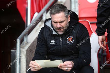 Blackpool first team coach David Dunn checks his lines