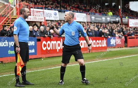 Scott Duncan match referee consults with his assistant regarding a penalty that was not awarded