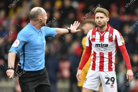 Scott Duncan match referee waves away Jacob Greaves of Cheltenham Town
