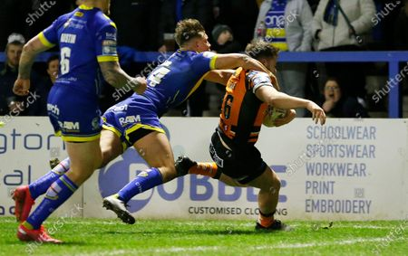 Stock Picture of Callum Turner of Castleford runs to the line but is caught by the neck by Keanan Brand of Warrington Wolves and is given a penalty try to bring Castleford 2 points ahead