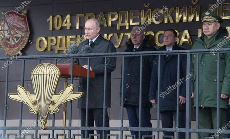 From left: Russian President Vladimir Putin, Presidential Plenipotentiary Envoy to the Northwestern Federal District Alexander Gutsan, Deputy Chairmen of the Federation Council of Russia Andrey Turchak and Minister of Defense of Russia Sergey Shoygu before are seen before reviewing the troops of the 104th Krasnoznamensky guards parachute regiment of the 76-th Airborne division near the Kupol memorial sign dedicated to the soldiers of the 6th parachute company in Cherekha village as part of the events commemorating the soldiers of the 6th parachute company, who died bravely during a clash with militia in Argun Gorge in 2000.