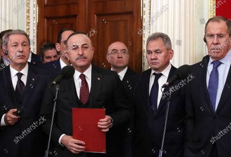 Turkish Foreign Minister Mevlut Cavusoglu (front 2-L), Russian Defense Minister Sergey Shoygu (2-R) and Russian Foreign Minister Sergey Lavrov (R) after Russian-Turkish talks at the Kremlin in Moscow, Russia, 05 March 2020. Russia and Turkey agreed to a ceasefire in Syrian Idlib starting from 06 March.
