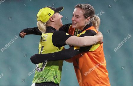 Australian teammates Ellyse Perry, right, and Delissa Kimmince hug after winning their Women's T20 World Cup cricket semifinal match against South Africa in Sydney