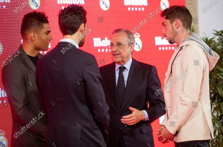Real Madrid's president Florentino Perez (2R) chats with the club's ambassador Alvaro Arbeloa (2L) and midfielders Casemiro (L) and Federico Valverde (R) during the event held to present the renewal of the sponsor contract between the club and Spanish beer brewer 'Mahou Cinco Estrellas' in Madrid, Spain, 05 March 2020.