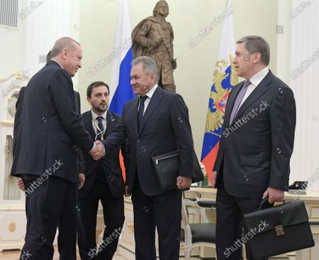 Turkish President Recep Tayyip Erdogan (left), Minister of Defense of Russia Sergey Shoygu (center) and Aide to the Russian President Yuri Ushakov (right) attend the talks between Russian President Vladimir Putin and Turkish President Recep Tayyip Erdogan in the Kremlin, Moscow