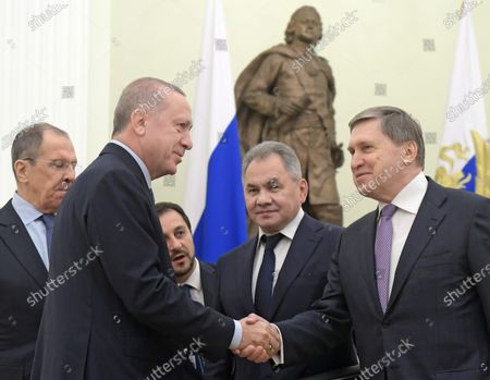 Turkish President Recep Tayyip Erdogan (second from left), Minister of Defense of Russia Sergey Shoygu (second from right), Aide to the Russian President Yuri Ushakov (right) and Russian Minister of Foreign Affairs Sergey Lavrov (left) attend the talks between Russian President Vladimir Putin and Turkish President Recep Tayyip Erdogan in the Kremlin, Moscow