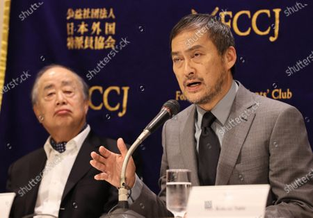 Stock Image of Ken Watanabe (R) and movie producer and book publisher Tsuguhiko Kadokawa (L) speak at the Foreign Correspondents' Club of Japan.