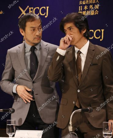 Japanese actors Ken Watanabe (L) and Koichi Sato (R) pose for photo at the Foreign Correspondents' Club of Japan.