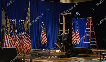 Workers breakdown the stage after an event where former New York mayor and businessman Michael Bloomberg spoke to his campaign staff after announcing that he was suspending his campaign for US president, in a hotel ballroom in New York, New York, USA, 04 March 2020. Bloomberg spent about 500 million US dollars of disown money running for president but did win enough delegates to justify staying in the race following yesterday's Super Tuesday's results.