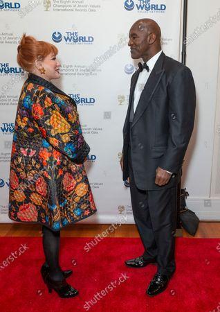 Ambassador Georgette Mosbacher and Evander Holyfield