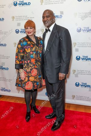 Stock Photo of Ambassador Georgette Mosbacher and Evander Holyfield