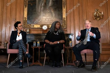 Dame Kelly Holmes (L) Anne Marie Imafidon (C) and British Prime Minister Boris Johnson (R), during a panel event and reception to mark International Women's Day in 10 Downing Street, Central London, Britain, 05 March 2020.