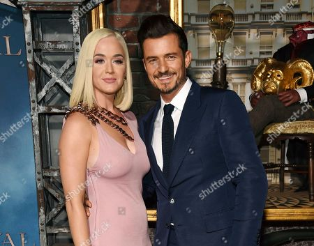 """Orlando Bloom, Katy Perry. Orlando Bloom, right, a cast member in the Amazon Prime Video series """"Carnival Row,"""" with singer Katy Perry, at the premiere of the series in Los Angeles. Perry has revealed she's pregnant at the end of the video for her latest song """"Never Worn White."""" The news was confirmed Thursday by Perry's label, Capitol Music Group. The baby will be Perry's first, and the second for her fiance, Orlando Bloom, who has a 9-year-old son, Flynn, with ex-wife Miranda Kerr"""