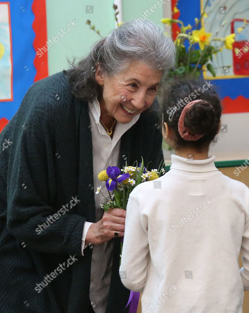 Felicity Dahl, widow of Roald Dahl, receives flowers during a visit to Bousfield Primary School in London to celebrate World Book Day.