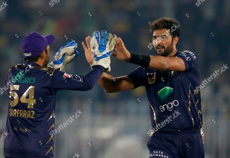 Stock Image of Sohail Khan, right, of Quetta Gladiators, celebrates with teammate after taking the wicket of Peshawar Zalmi batsman Imam-ul-Haq during a Pakistan Super League T20 cricket match, in Rawalpindi, Pakistan