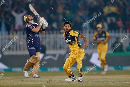 Stock Image of Peshawar Zalmi pacer Hasan Ali, center, celebrates after taking the wicket of Quetta Gladiators batsman Shane Watson, left, during a Pakistan Super League T20 cricket match, in Rawalpindi, Pakistan