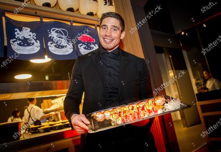 Stock Picture of Dutch world champion kickboxing Rico Verhoeven poses prior to the opening of his fast-casual restaurant in collaboration with Eveline Wu (R), in Eindhoven, The Netherlands, 05 March 2020.